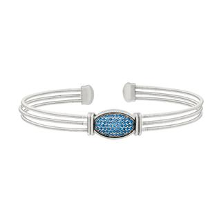 Flexible sterling silver bracelet with simulated blue sapphires