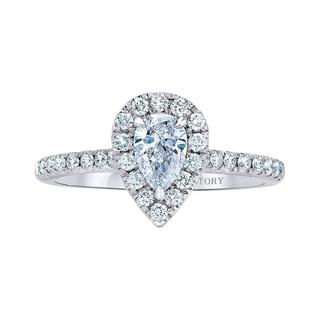 White gold engagement ring with pear shape center