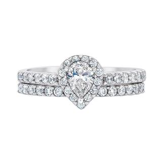 White gold bridal set with pear shape engagement ring center