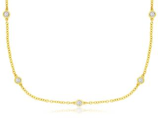 Yellow gold diamond nine station necklace