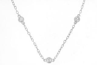 White gold sixteen diamond station necklace