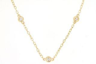 Yellow gold sixteen diamond station necklace