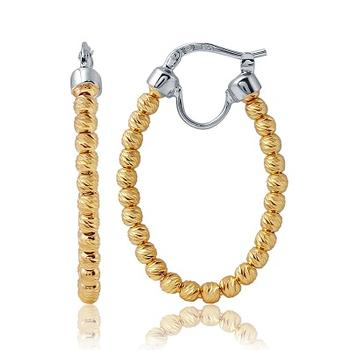 Sterling silver hoop earrings with a yellow gold finish