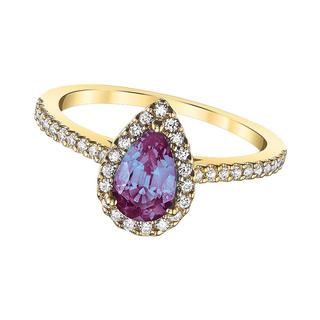 Yellow gold diamond ring with created alexandrite center
