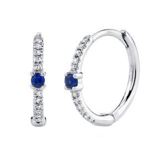 Diamond and sapphire huggie earrings in white gold