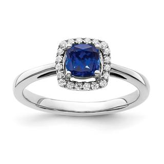 Created blue sapphire and diamond ring in white gold