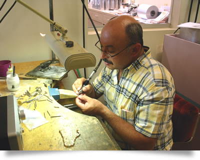 Roman our in-house designer at his jewelry bench